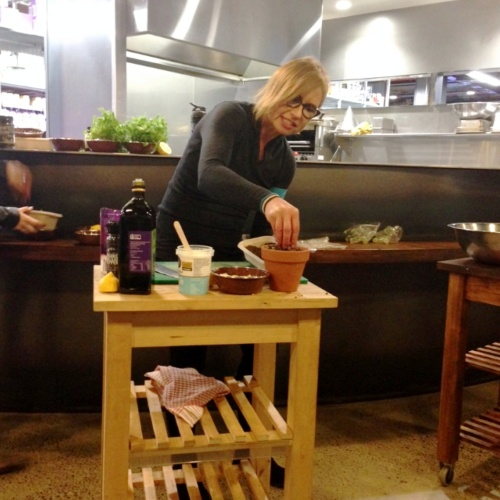 Teresa Cutter preparing her edible Flower Pot Salad